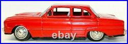 Vintage Japanese Tin Friction 1961 Ford Falcon Cherry Red 4-door Hardtop